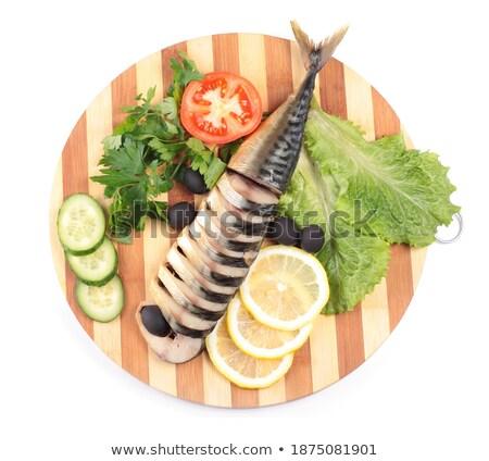 sliced herring on wooden plate Stock photo © shutswis