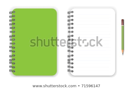 Writing an on a blank office note with a green pencil Stock photo © Lightsource