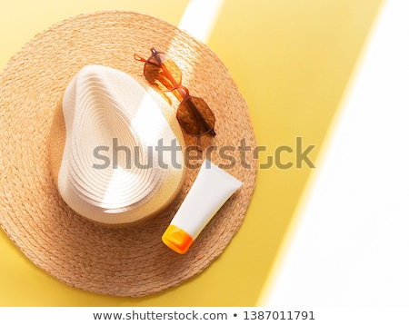 sunprotection summer holiday sunglasses and cream Stock photo © juniart