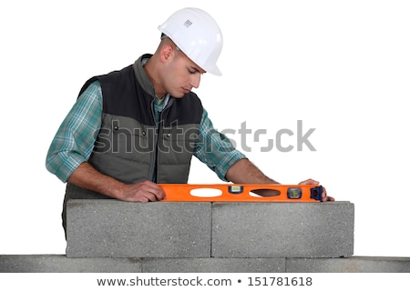 Mason making necessary checks with spirit level Stock photo © photography33