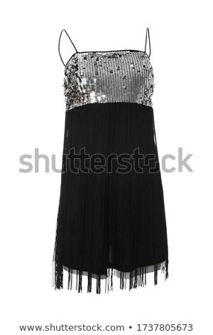 Beautiful girl in trendy sleeveless attire Stock photo © stockyimages
