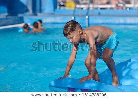 Ninos natación relajante familia mar Foto stock © meinzahn