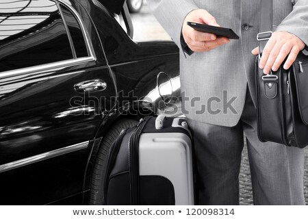 Business execitives in taxi cab Stock photo © stockyimages
