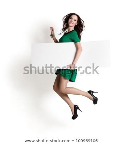 Woman in green dress with blank board Stock photo © Elnur