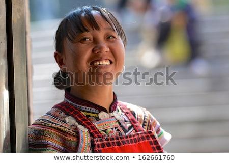 Chinês minoria nacionalidade menina rosto sorridente colorido Foto stock © elwynn