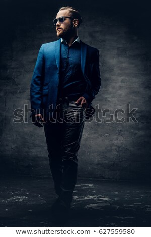 guy on the dark background with sunglasses stock photo © restyler