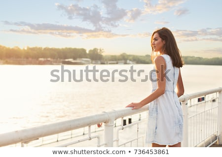 woman sitting on riverside stock photo © petrmalyshev