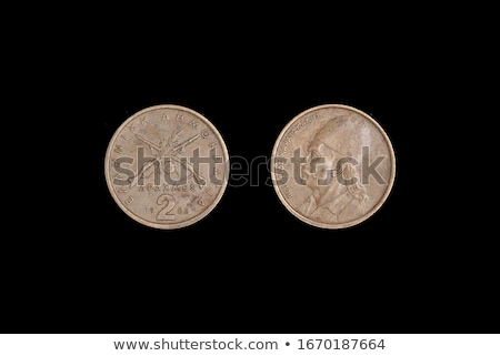 Two Collectible coins on a Black Background. Stock photo © tashatuvango