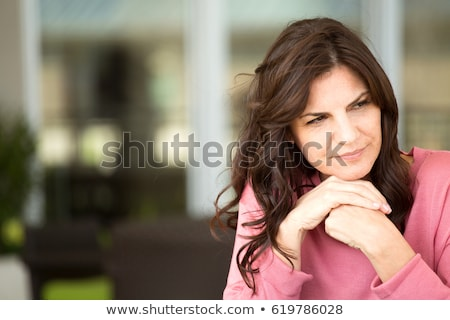 Komoly középkorú nő barna hajú visel fehér szemüveg Stock fotó © arenacreative