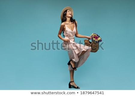 Magas fiatal nő fekete ruházat kézitáska izolált Stock fotó © Elnur
