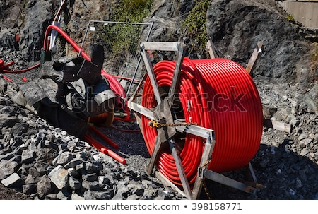 red rolled up wire pipe on an industrial construction site Stock photo © Melvin07