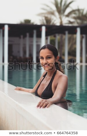 Young woman in a bikini standing daydreaming Stock photo © dash