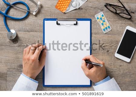 Doctor's hand writing prescription Stock photo © stevanovicigor