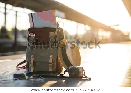Traveler with backpack looking at map. Stock photo © RAStudio