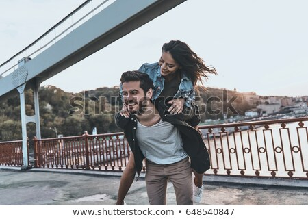 couple piggy backing Stock photo © IS2