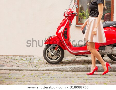 Woman with red scooter Stock photo © IS2