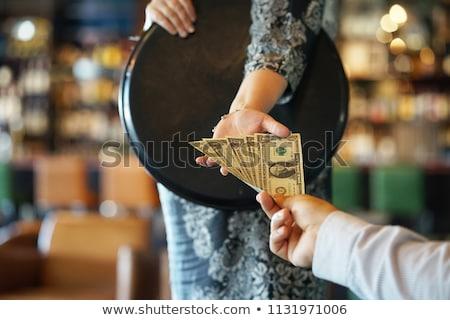 Pincér borravaló nő pénz férfi dolgozik Stock fotó © IS2
