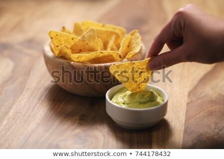 Delicious nachos and sauces on table Stock photo © dash