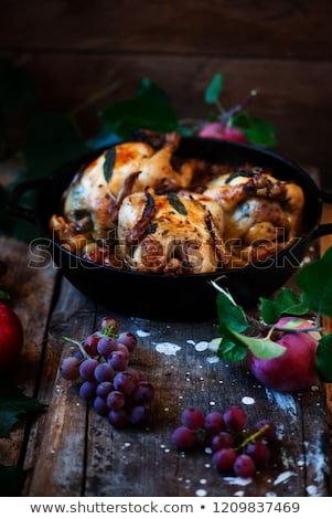 Roasted  cornish hens with grapes and apples. Stock photo © zoryanchik