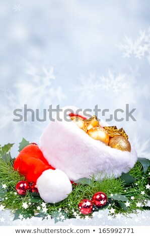 Blue Christmas Background with Baubles and Light Beams Stock photo © derocz