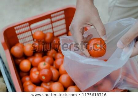 Kadın çanta satın alma domates bakkal satış Stok fotoğraf © dolgachov