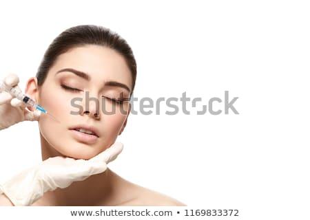 atraente · mulher · jovem · cosmético · injeção · isolado · azul - foto stock © ruslanshramko