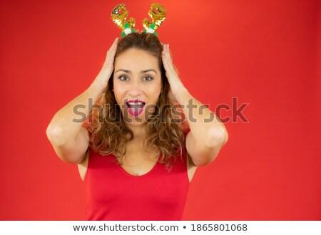 Töprengő fiatal lány visel piros mikulás kalap Stock fotó © deandrobot