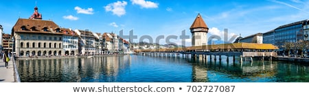 Luzern panoramic evening view of famous landmarks and Reuss rive Stock photo © xbrchx