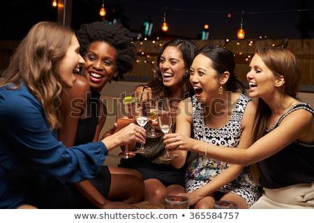woman with friends drinking cocktail at restaurant Stock photo © dolgachov