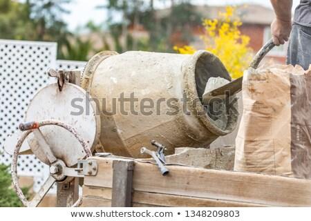 работник цемент строительная площадка строительство человек мужчины Сток-фото © feverpitch