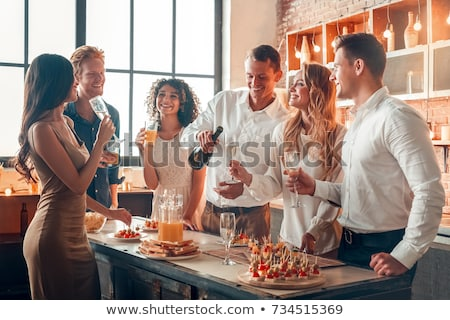 Friends at home party Stock photo © pressmaster