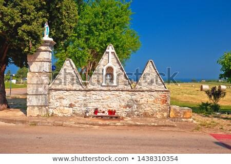 Religious stone monument in Dajla view Stock photo © xbrchx