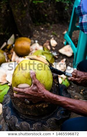 Férfi tapsolás kókusz nagy kés közelkép Stock fotó © boggy