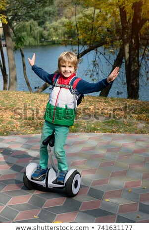 Boy Riding on Personal Transporter in Park Stock photo © robuart