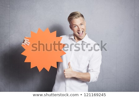 Man giving thumbs up at empty sign promoting sales. Stock photo © lichtmeister