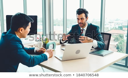 Young Businesspeople Discussing Data In Meeting Room Stock photo © AndreyPopov