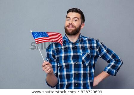 Gelukkig man Amerikaanse vlag grijs burgerschap jonge man Stockfoto © dolgachov