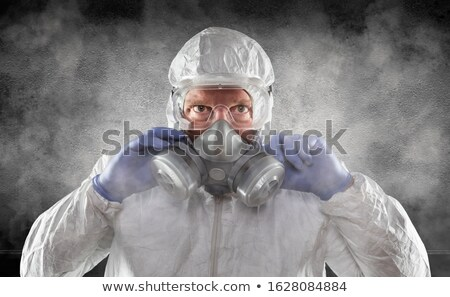 Man Wearing Hazmat Suit, Goggles and Gas Mask Is Smokey Dark Roo Stock photo © feverpitch