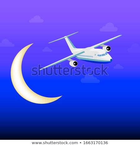Blanche avion battant nuages nuit sombre Photo stock © Zhukow