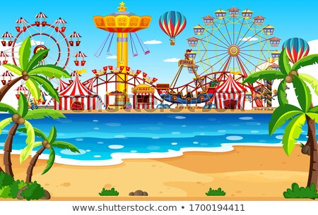 Themepark scene with many rides by the beach Stock photo © bluering