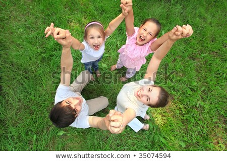 parents stand having joined hands with daughter Stock photo © Paha_L