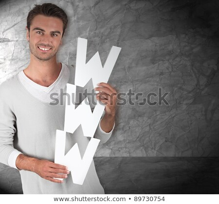 Young man holding the letters WWW Stock photo © photography33