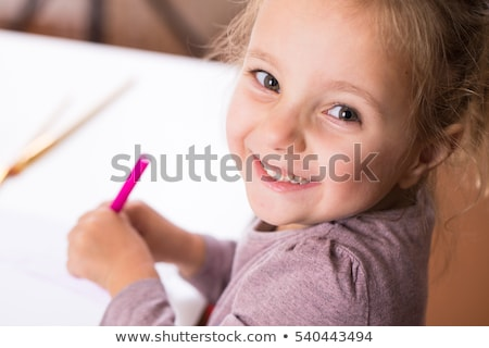 little girl drawing with colored crayons stock photo © photography33