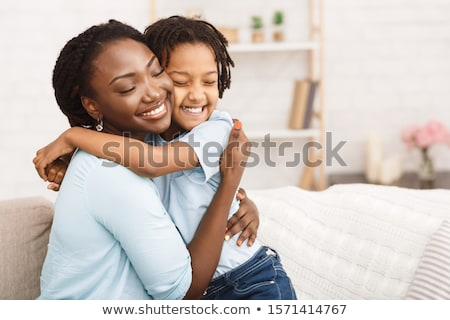 Woman hugging her child Stock photo © photography33