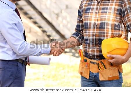 Architect shaking laborer's hand Stock photo © photography33