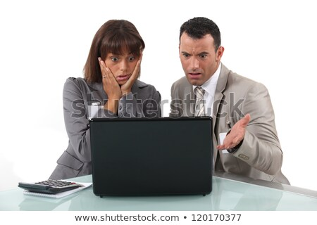 A couple of businesspeople getting bad news. Stock photo © photography33