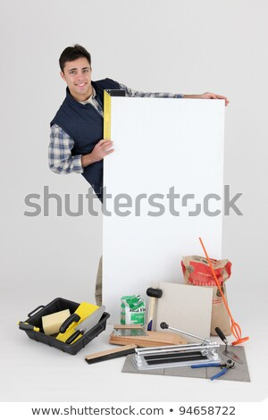 Builder posing with his tools and building supplies Stock photo © photography33
