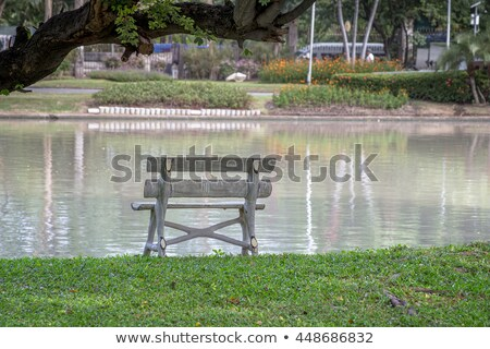 White chair on the balcony, near the pond Stock photo © happydancing