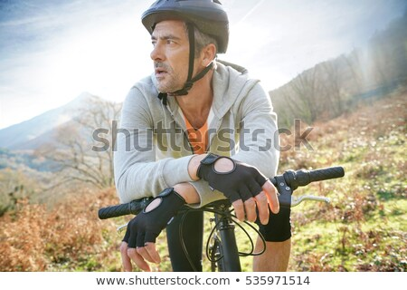 mature man on a bike ride in the forest stock photo © photography33