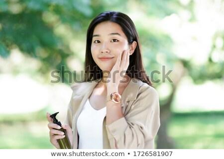 mosolyog · fiatal · nő · tart · krém · üveg · kacsintás - stock fotó © anna_om